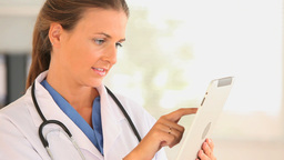 Female doctor using a tablet computer Stock Video Footage