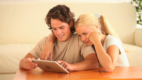 Couple using a tablet computer Stock Video Footage