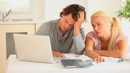Sad couple checking at their account Stock Video Footage