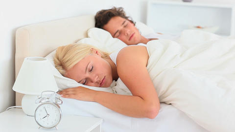 Sleeping couple not wanting to wake up Stock Video Footage