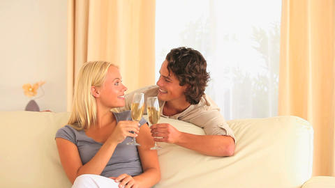 Happy couple toasting with Champagne Stock Video Footage