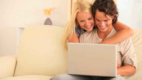 Couple with a laptop on a sofa Footage