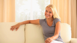 Laughing woman sitting on a sofa Stock Video Footage