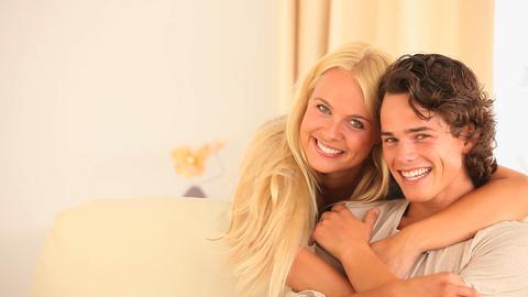 Happy couple on a sofa Footage