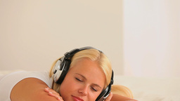 Relaxing woman with earphones Stock Video Footage