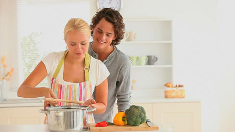 Happy couple cooking together Stock Video Footage