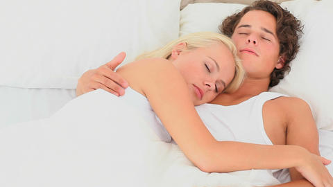 Cuddling couple in a bed Footage