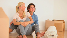 Happy couple sitting on the floor Stock Video Footage