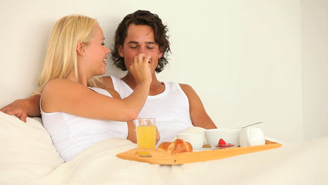 Couple enjoying their breakfast in bed Footage