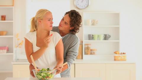 Happy couple preparing thier salad Footage