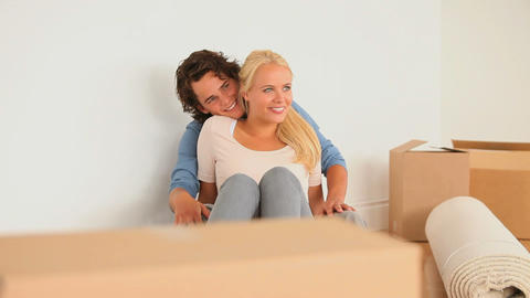 Couple enjoying being in their new livingroom Stock Video Footage