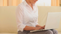 Shorthaired woman working on a laptop Stock Video Footage