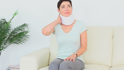 Woman having neck pains Footage