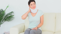 Woman having neck pains Stock Video Footage