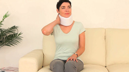 Quiet woman having neck pain Stock Video Footage