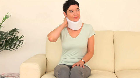 Quiet woman having neck pain Stock Video Footage