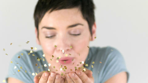 Woman blowing golden sparkles out of her hands in  Footage