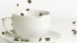 Coffee beans poured on a cup in slow motion Stock Video Footage