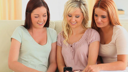 Women looking at a smartphone Stock Video Footage