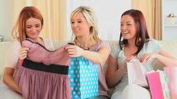 Cute women compairing their shopping Stock Video Footage
