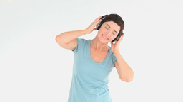 Charming woman with headphones Footage