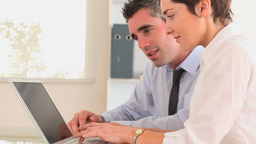 Businesspeople with a laptop Animation