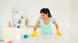 Cute woman cleaning the kitchen counter Footage