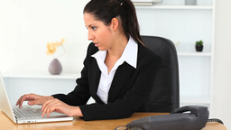 Businesswoman typing on a laptop Footage