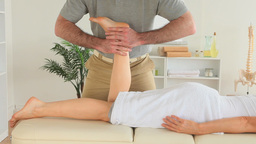 Chiropractor massaging a womans foot Stock Video Footage
