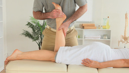 Chiropractor massaging a womans foot Footage