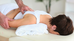 Chiropractor massaging a cute womans back Footage