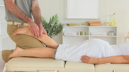 Masseur massaging a cute womans leg Footage