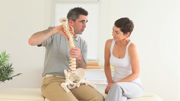 Chiropractor Explaining The Spine stock footage