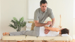 Chiropractor stretching a womans back Footage