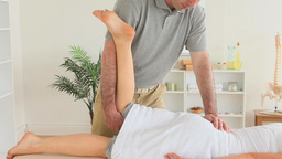 Man Stretching A Womans Leg stock footage