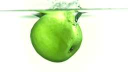Apple splashing into water in super slow motion Footage