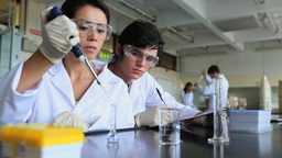 Young scientists experimenting Stock Video Footage