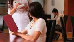 Young woman sitting at a table Stock Video Footage