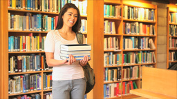 Cute woman holding books Footage