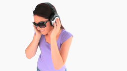 Charming woman with headphones and sunglasses Footage