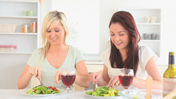 Laughing women having dinner together Footage