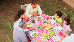 Family eating outdoors together Stock Video Footage