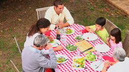 Family eating outdoors together Footage