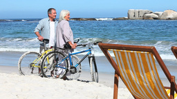 Couple with bikes exploring a beach Footage