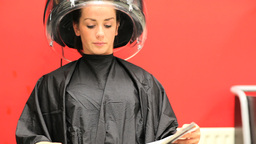 Woman under a hairdressing machine Footage