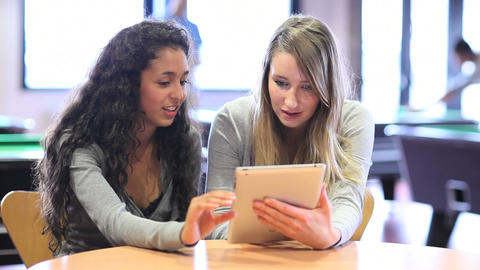 Fellow students using a tablet computer Footage