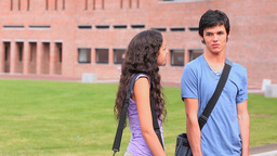 Good looking students flirting Stock Video Footage