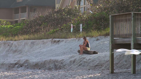 0119 Girl Sitting Wating Sunset on Beach Stock Video Footage