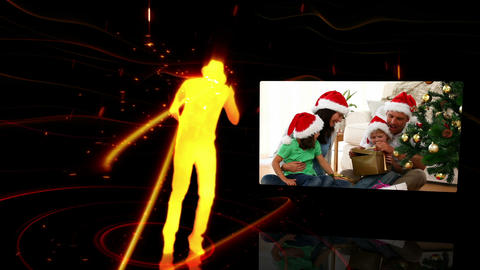 Silhouette dancing while a video of a family at Christmas time appears to the Animation
