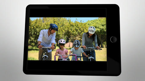 Animated tablet computer showing family having fun Stock Video Footage